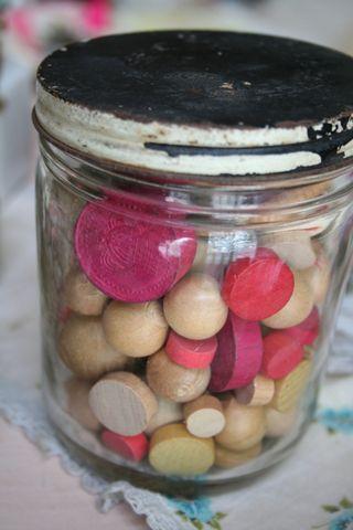 Jar of wood beads